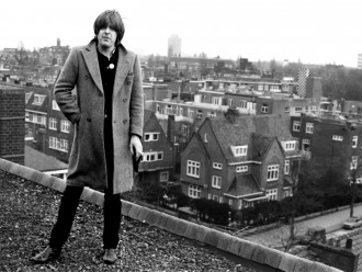 NICK LOWE on a rooftop in Amsterdam,  The Netherlands winter 1978  Exclusive  Photo: Barry Schultz
